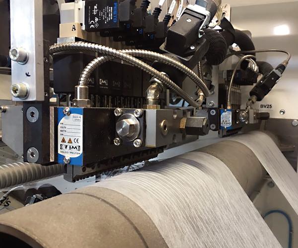Nonwovens-elastics-gluing-diaper-manufacturing